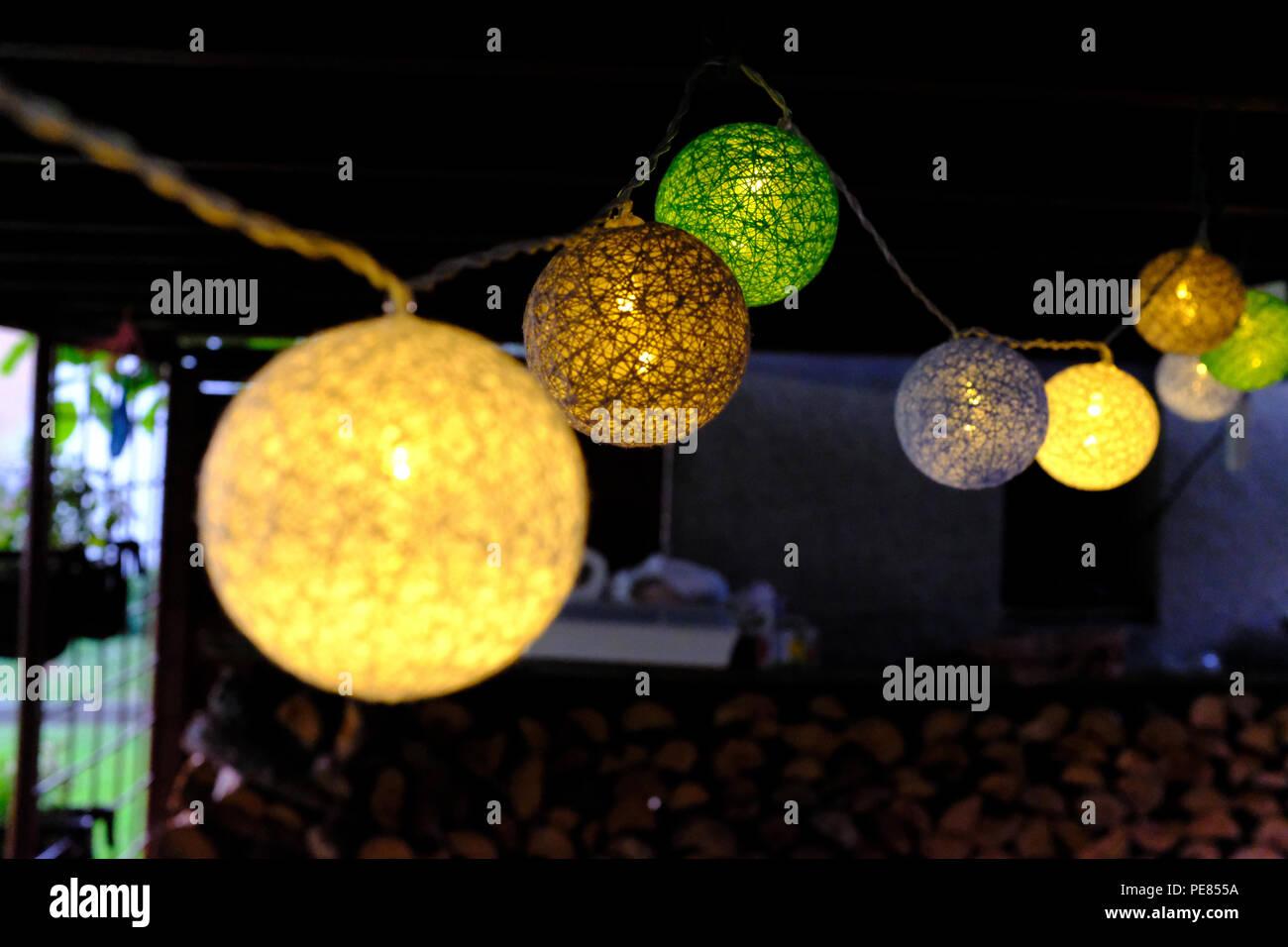 Solar garden lights at night time - Stock Image