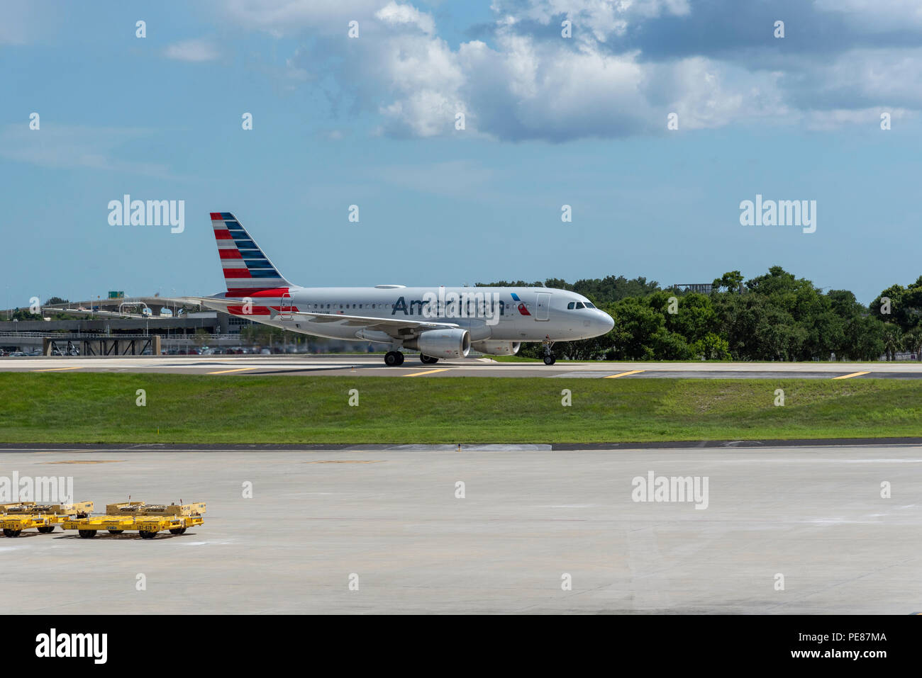 Aircraft taxiway on elevated section at Tampa International Airport, Florida, USA. 2018. An American comapny Airbus A319 on the taxiway Stock Photo