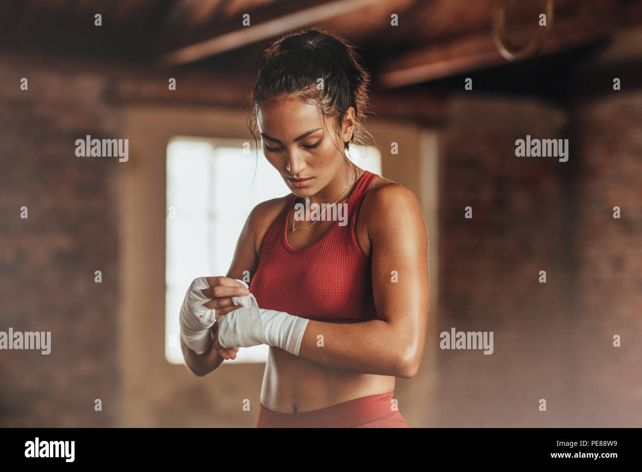 Female Boxer Wearing Strap On Wrist Fitness Young Woman With