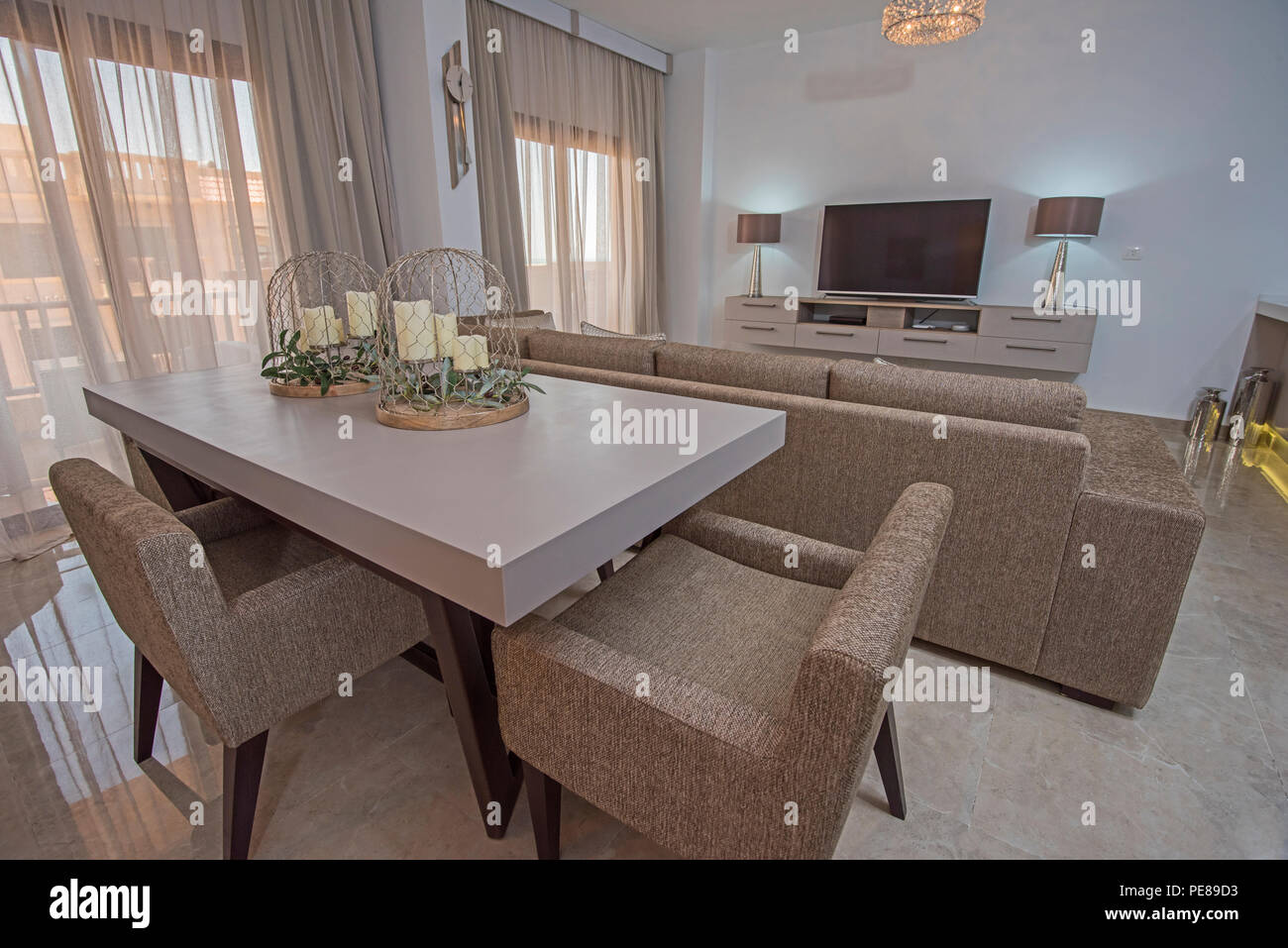 Living room lounge with dining table in luxury apartment ...