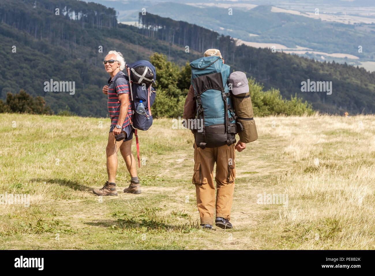 Seniors hiking, Bile Karpaty Mountains, White Carpathians, Czech Slovakian border, Czech Republic, Slovakia - Stock Image