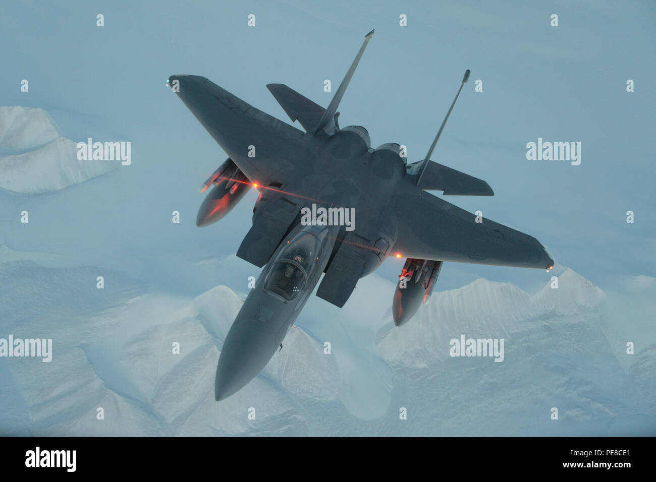 A United States Air Force F-15C Eagle from the 144th Fighter Wing flies above the High Arctic, Oct. 22, 2015. From Oct. 15-26, 2015, approximately 700 members from the Canadian Armed forces, the United States Air Force, the United States Navy, and the United States Air National Guard are deploying to Iqaluit, Nunavut, and 5 Wing Goose Bay, Newfoundland and Labrador for Exercise Vigilant Shield 16. (US Air National Guard photo by Master Sgt. David J. Loeffler/released) Stock Photo