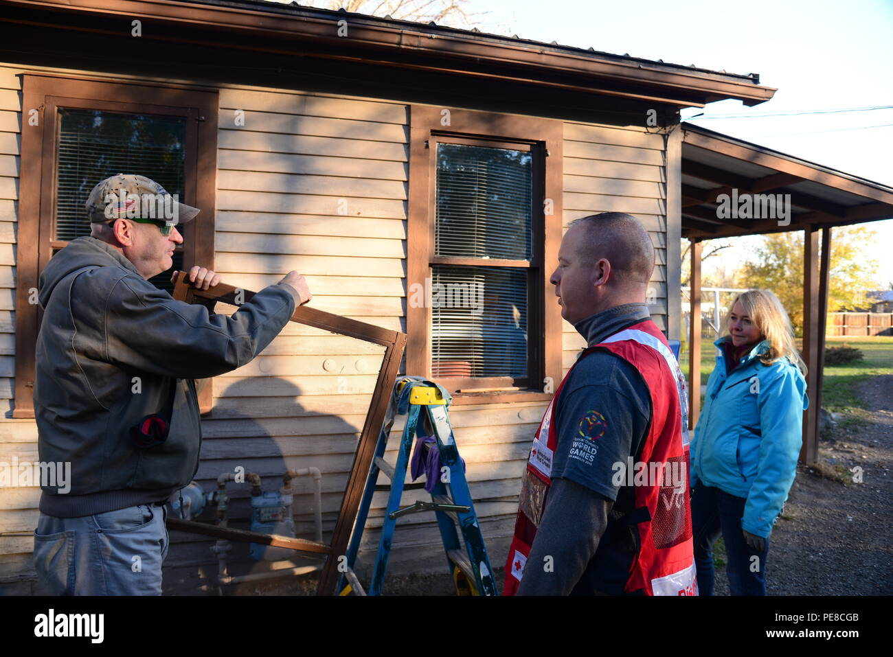 Airmen From Malmstrom Air Force Base And Federal Employees Volunteer Wiring A Smoke Detector To Perform Household Chores Install Detectors For The Day Of Caring Oct 23