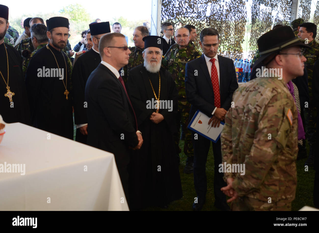 Archbishop Timotei, Archbishop of Arad, Romania visits the U.S. and Romanian Soldiers at a ceremony near Arad, Romania, during Exercise Dragoon Crossing – Romania, Oct. 24-26, 2015. s a strengthening of NATO's persistent presence in the region in support of Operation Atlantic Resolve. (U.S. Army photo by Staff Sgt. Steven M. Colvin/10th Press Camp Headquarters) - Stock Image