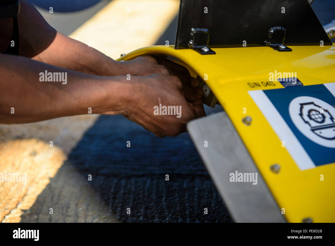 151023-N-RZ218-046   BAHAMAS (Oct. 23, 2015) Olden Glover, a contractor with Phoenix International Incorporated, prepares the tow pinger locater 25 (TPL 25) for the upcoming salvage mission aboard USNS Apache (T-ATF 172). USNS Apache departed Norfolk, Va., Oct. 19, to begin searching for wreckage from the missing U.S. Flagged merchant vessel El Faro. The ship is equipped with several pieces of underwater search equipment, including a voyage data recorder locator, side-scan sonar and an underwater remote operated vehicle. The Navy's mission will be to first locate the ship and, if possible, to  - Stock Image