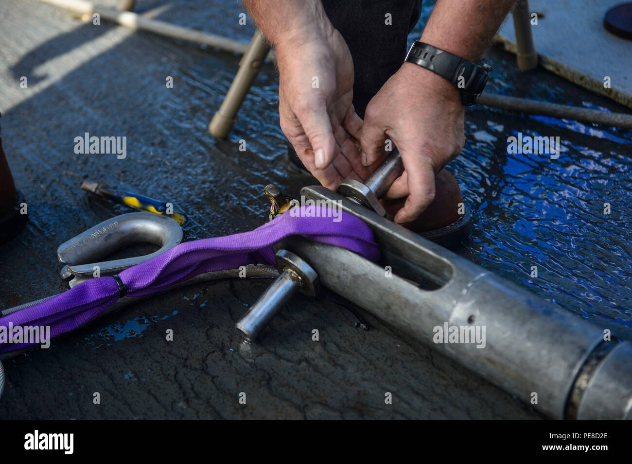 151023-N-RZ218-092   BAHAMAS (Oct. 23, 2015) A contractor with Phoenix International Incorporated, prepare a tow pinger locater 25 (TPL 25) for the upcoming salvage mission aboard USNS Apache (T-ATF 172). USNS Apache departed Norfolk, Va., Oct. 19, to begin searching for wreckage from the missing U.S. Flagged merchant vessel El Faro. The ship is equipped with several pieces of underwater search equipment, including a voyage data recorder locator, side-scan sonar and an underwater remote operated vehicle. The Navy's mission will be to first locate the ship and, if possible, to retrieve the voya - Stock Image