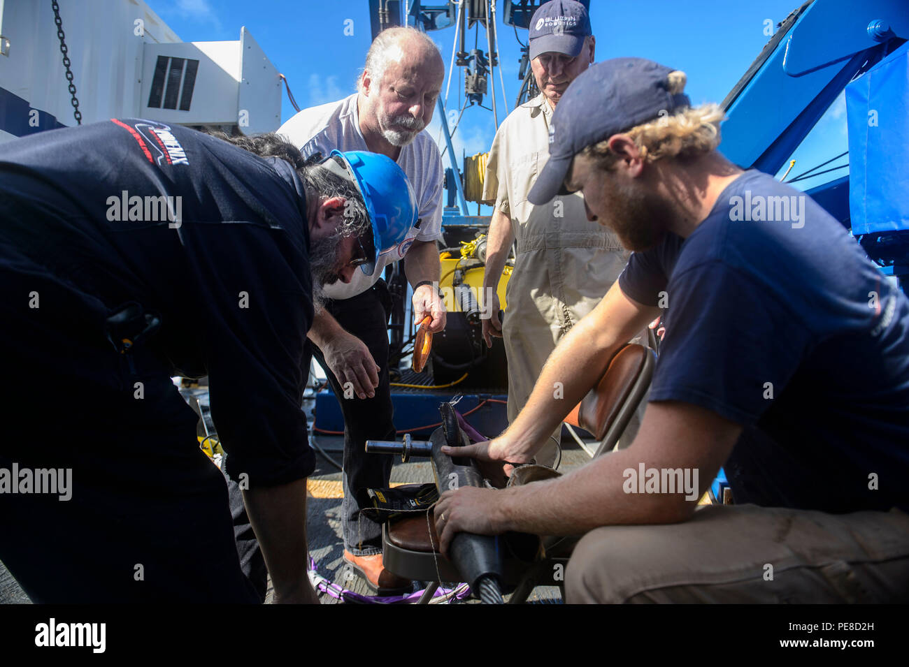 151023-N-RZ218-131   BAHAMAS (Oct. 23, 2015) Contractors with Phoenix International Incorporated prepare a tow pinger locater 25 (TPL 25) for the upcoming salvage mission aboard USNS Apache (T-ATF 172). USNS Apache departed Norfolk, Va., Oct. 19, to begin searching for wreckage from the missing U.S. Flagged merchant vessel El Faro. The ship is equipped with several pieces of underwater search equipment, including a voyage data recorder locator, side-scan sonar and an underwater remote operated vehicle. The Navy's mission will be to first locate the ship and, if possible, to retrieve the voyage Stock Photo