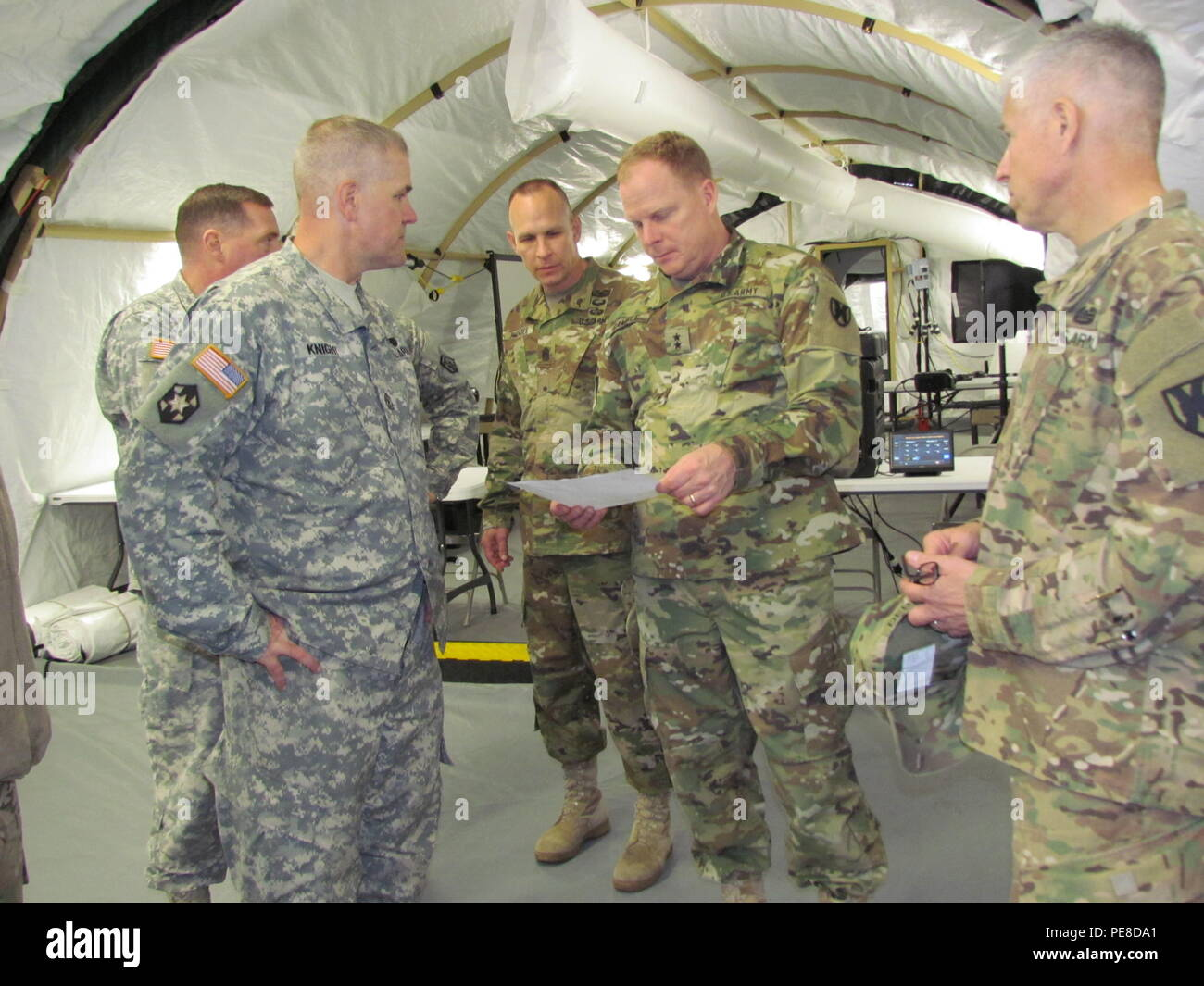 Maj. Gen. Duane Gamble, commanding general of the 21st Theater Support Command, examines schematics of the 7th Mission Support Command's tactical command post Monday, Oct. 26, 2015, at Panzer Kaserne in Kaiserslautern, Germany. The 6,000 square foot star-shaped tactical command post is a modular, portable and expandable system that can quickly be built to provide a brigade-sized operations center and shelter for up to 200 people. (Photo by Lt. Col. Jefferson Wolfe, 7th Mission Support Command Public Affairs Officer) - Stock Image