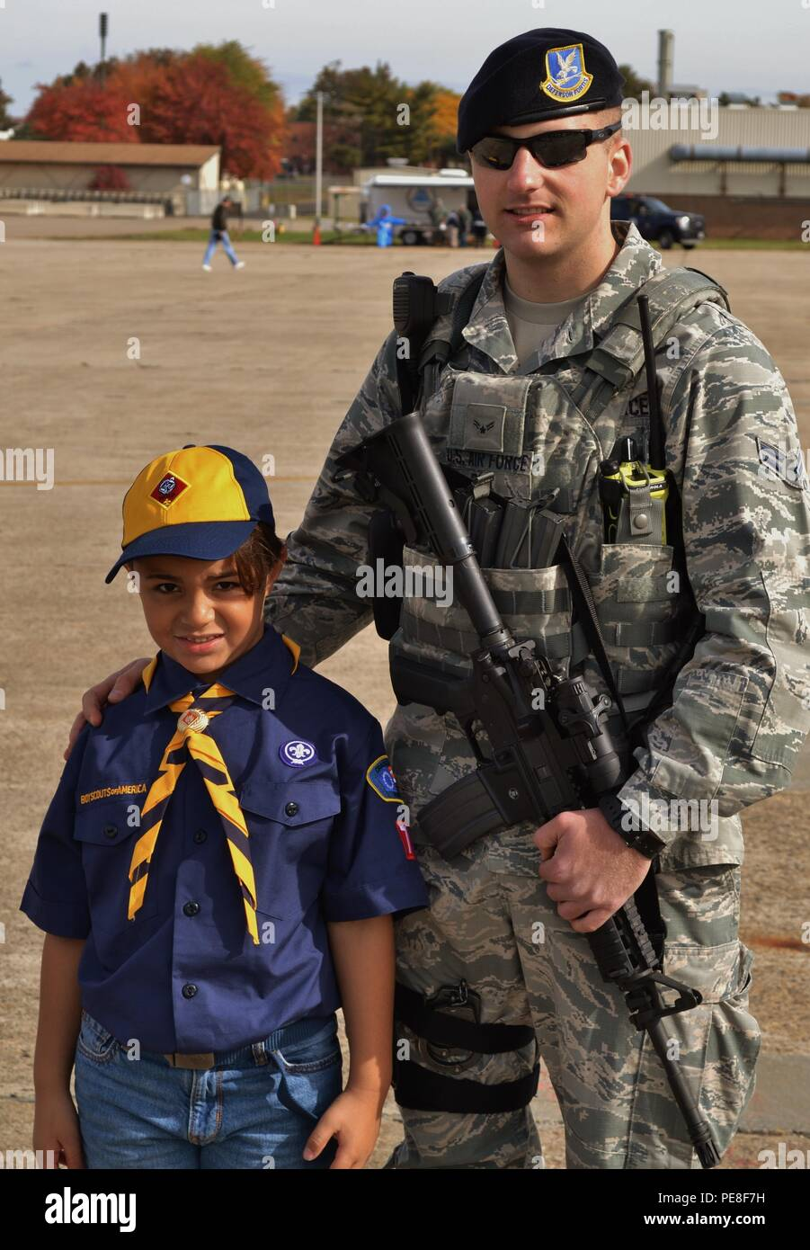 """Giovanni Dilalogue, a Wolf Scout from Troop 72, part of the Cradle of Liberty Council, Boy Scouts of America, stands for a photo with 111th Security Forces member Airman 1st Class Timothy Rihl during the """"Rocket Into Scouting"""" recruiting event hosted by the 111th Attack Wing, Oct. 24, 2015, at Horsham Air Guard Station, Pa. The wing hosted more than 700 Scouts and their families, supplying food and entertainment, along with the chance for some Scouts to earn their Aviation Merit Badge. (U.S. Air National Guard photo by Senior Airman Michael Bolden/Released) - Stock Image"""