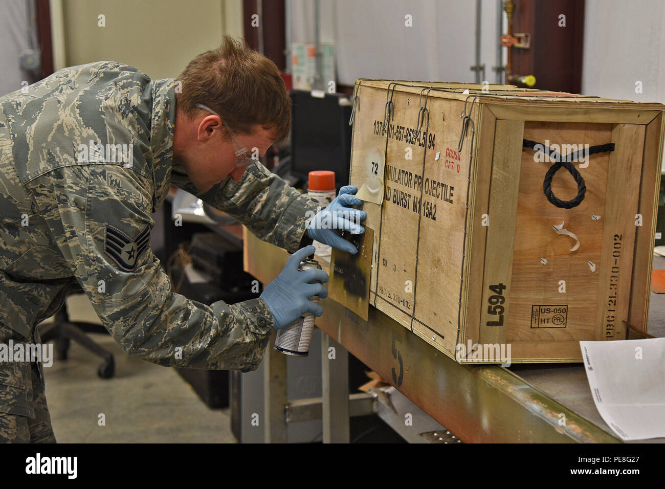 Staff Sgt. James Koenig, 92nd Maintenance Squadron senior munitions inspection, prepares a munitions package for account delivery and storage Oct. 28, 2015, at Fairchild Air Force Base, Wash. Koenig conducts a receiving inspection when shipments arrive and ensures boxes haven't been damaged. Munitions storage then moves the ammo to a superstructure storage location. (U.S. Air Force photo/Airman 1st Class Mackenzie Richardson) - Stock Image
