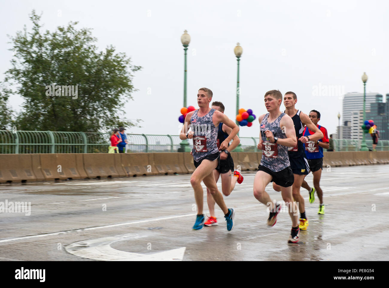 two-members-of-the-u-s-army-running-team-trevor-lafontaine-54-from-cornwall-n-y-and-daniel-schlich-55-from-saint-robert-mo-cross-the-francis