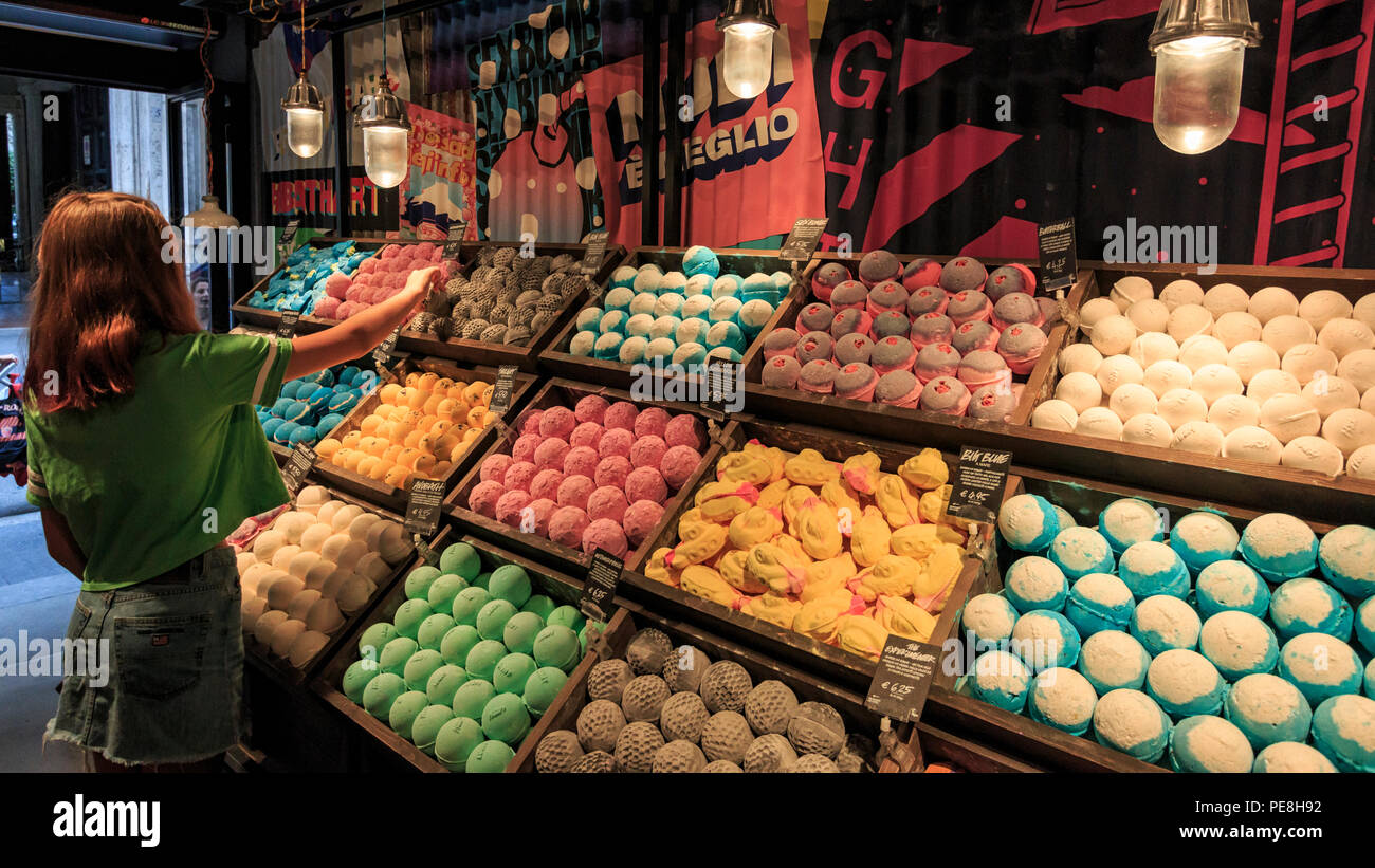 Rome, Italy - June 13, 2018: Young girl buying a bath bomb in a store in Rome, Italy - Stock Image