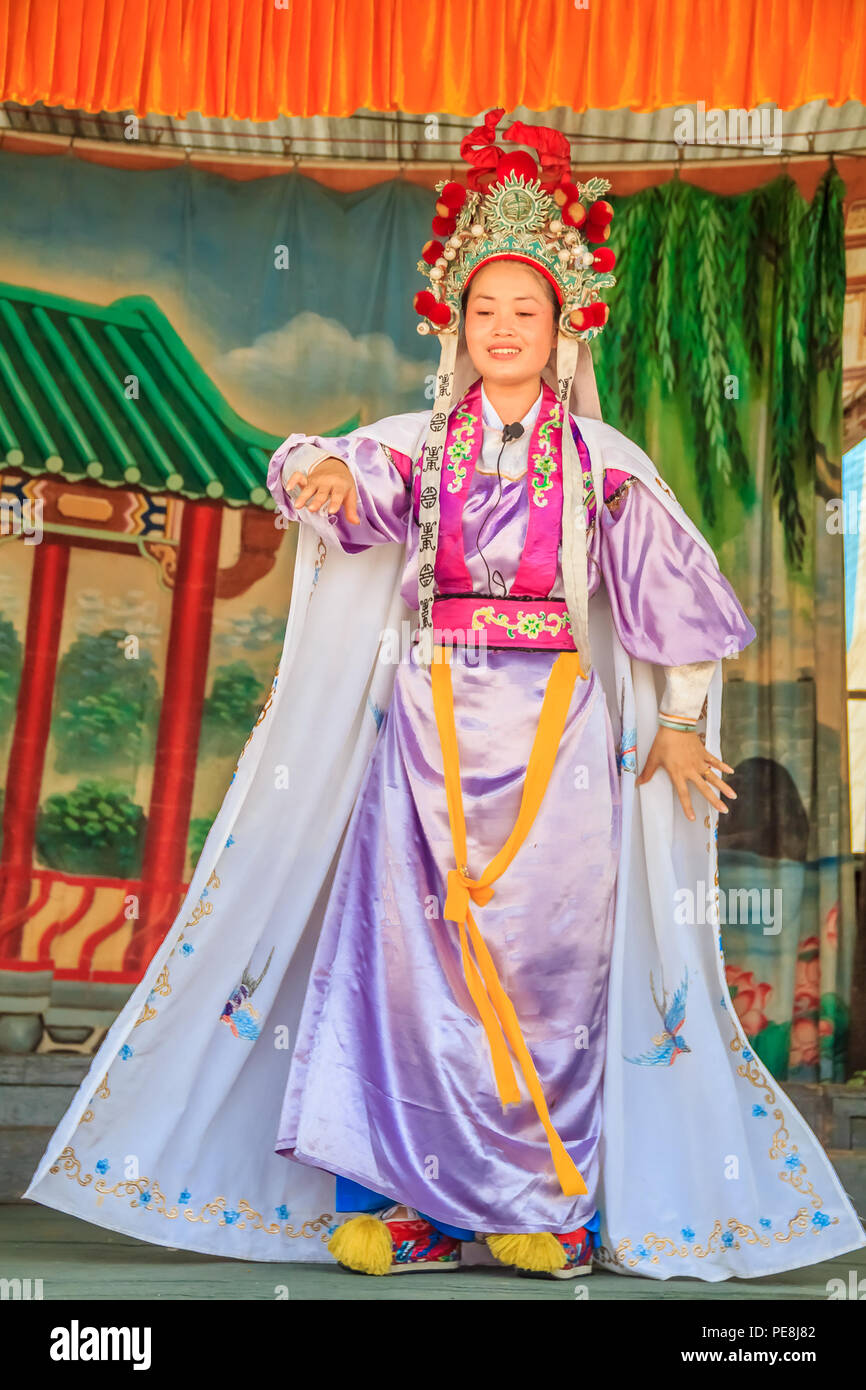 Georgetown, Penang, Malaysia - August 23, 2013: Chinese opera actors performming a public show. Chinese opera orginated in the Tang dynasty cira 720 A - Stock Image