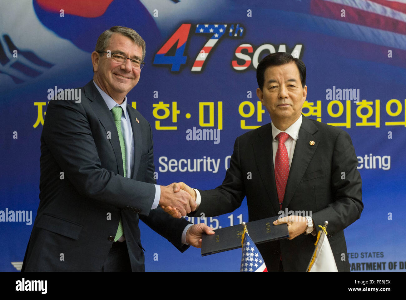 Secretary of Defense Ash Carter shakes hands with Republic of Korea Minister of Defense Minkoo Han at the conclusion of the 47th annual  U.S. - Korea Security Consultative Meeting Plenary Session in Seoul, Republic of Korea Nov. 2, 2015. The two leaders met to discuss matters of mutual importance. (Photo by Senior Master Sgt. Adrian Cadiz)(Released) Stock Photo
