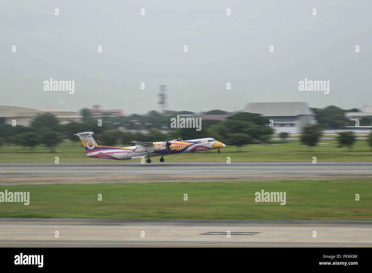 Bangkok, Thailand, 13th Aug 2018: Nok Air Reg. no. HS-DQA Dash8 Q400 Flight DD9114 taking off from DMK to Roi Et (ROI) - Stock Image