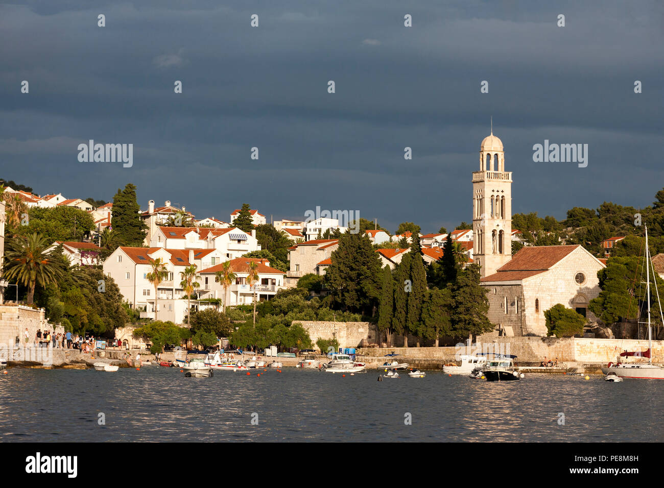 The campanile of the 15th century Franciscan Monastery, Hvar, Croatia, seen from across the harbour Stock Photo