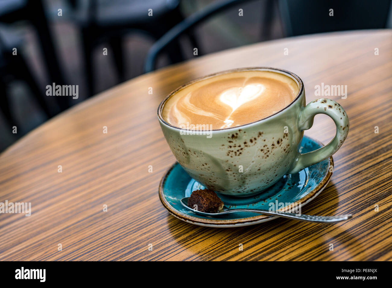 Close-up of cup with coffee latte and cappuccino with heart shape in milk froth from above as background Stock Photo