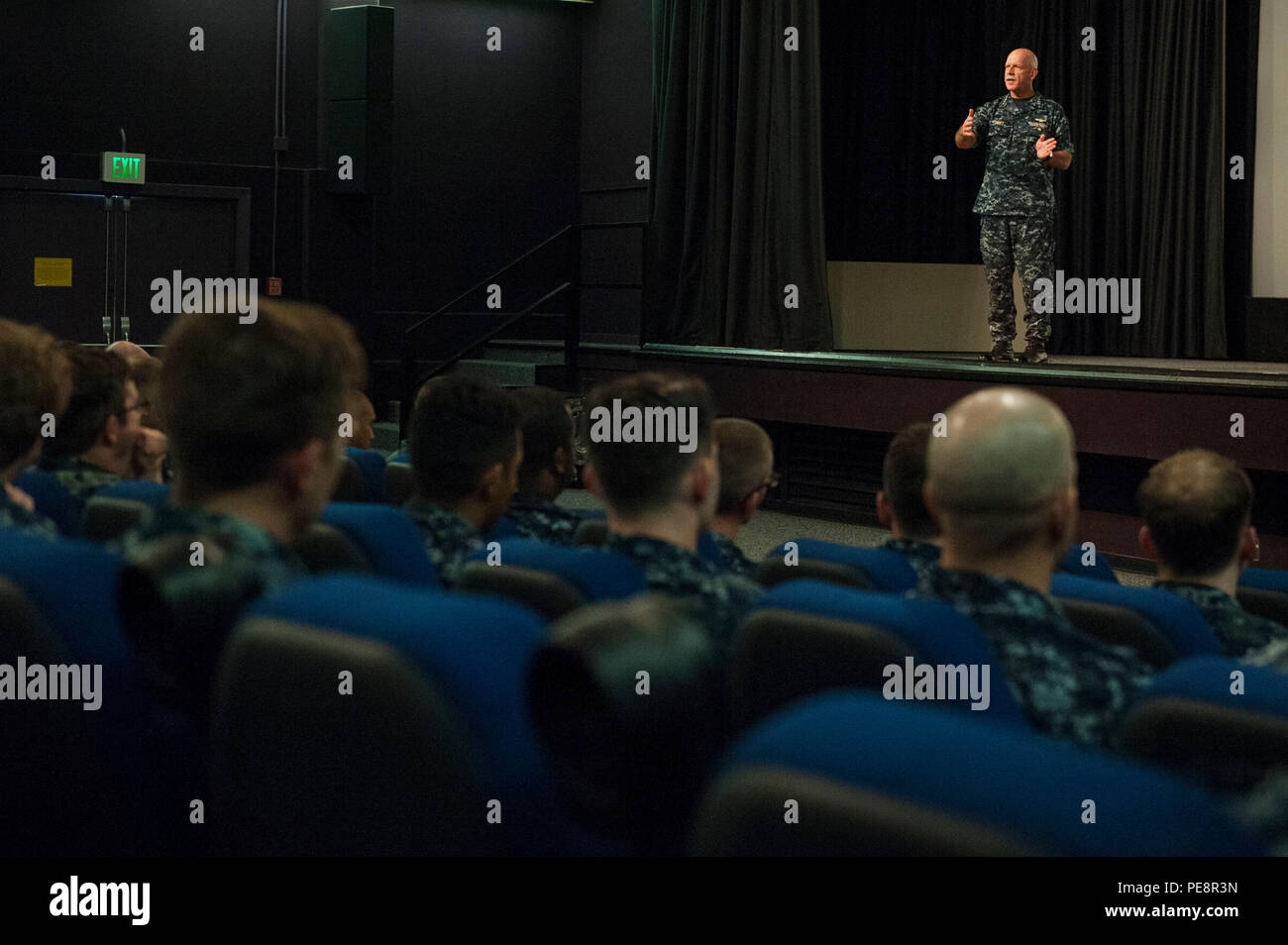 Adm. Scott Swift, commander U.S. Pacific Fleet, speaks to more than 350 Sailors at an all-hands call held at Pearl Harbor. Swift co-hosted the all-hands call with Pacific Fleet Master Chief Suz Whitman and they addressed questions about maternity and paternity leave, deployment schedules, physical fitness and overall state of the Pacific Fleet. (U.S. Air Force photo by Staff Sgt. Christopher Hubenthal) - Stock Image