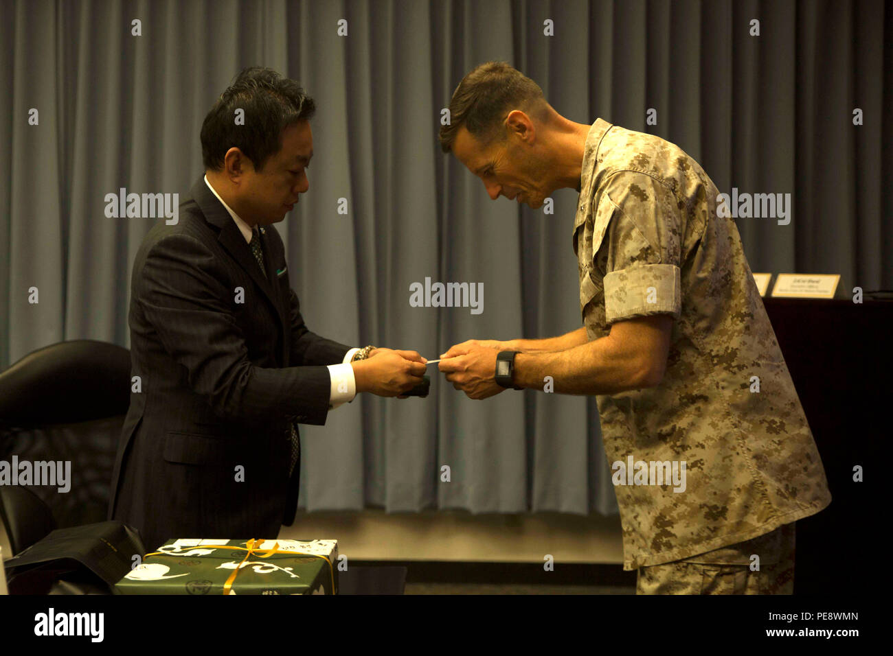 Japan russia stock photos japan russia stock images alamy masaoki fukui left exchanges business cards with lt col james j reheart Images