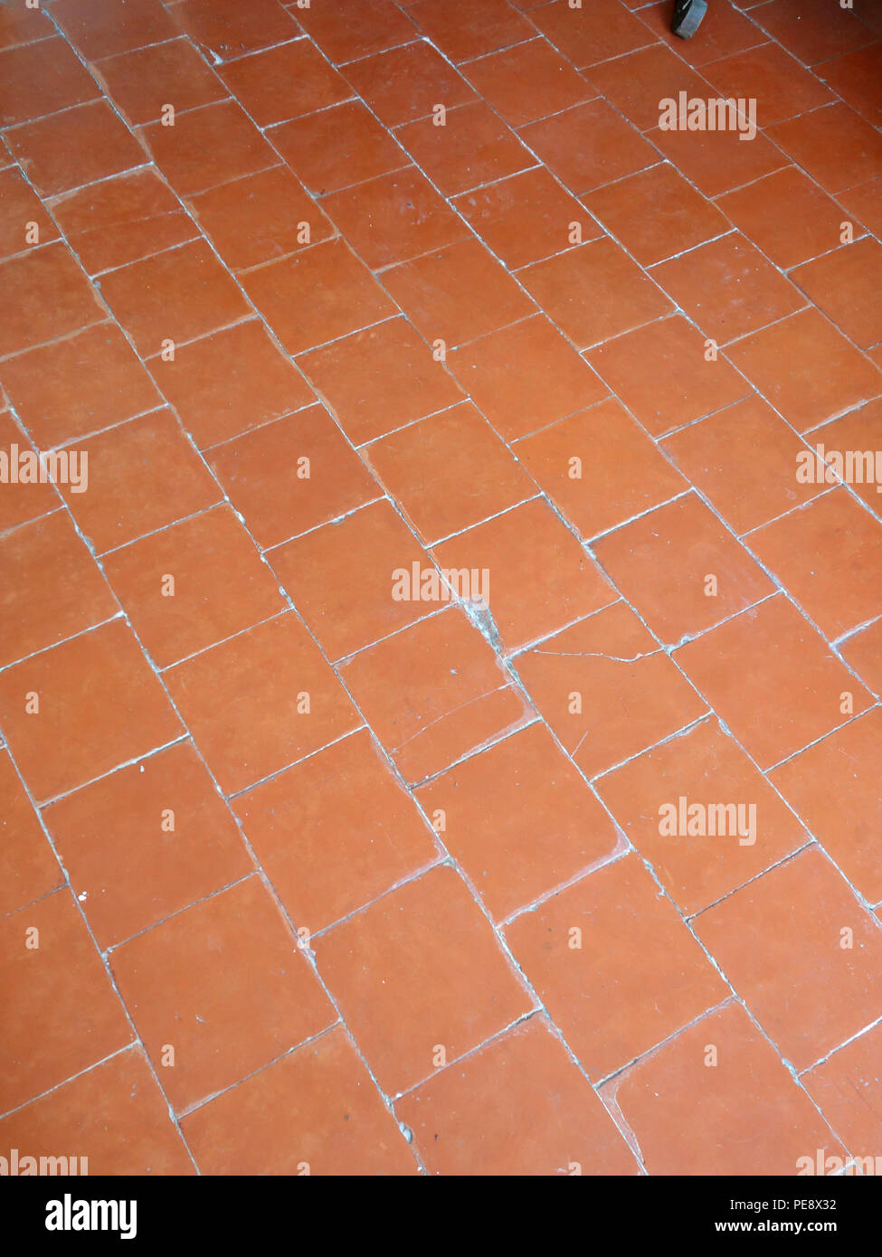 red antique floor tiles in a large french house stock image - Antique Floor Tiles