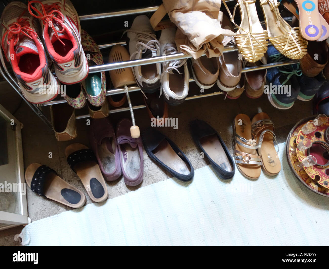 f120a5ead587f8 Shoe rack collection in a 20 year old girls bedroom in a large French house  -