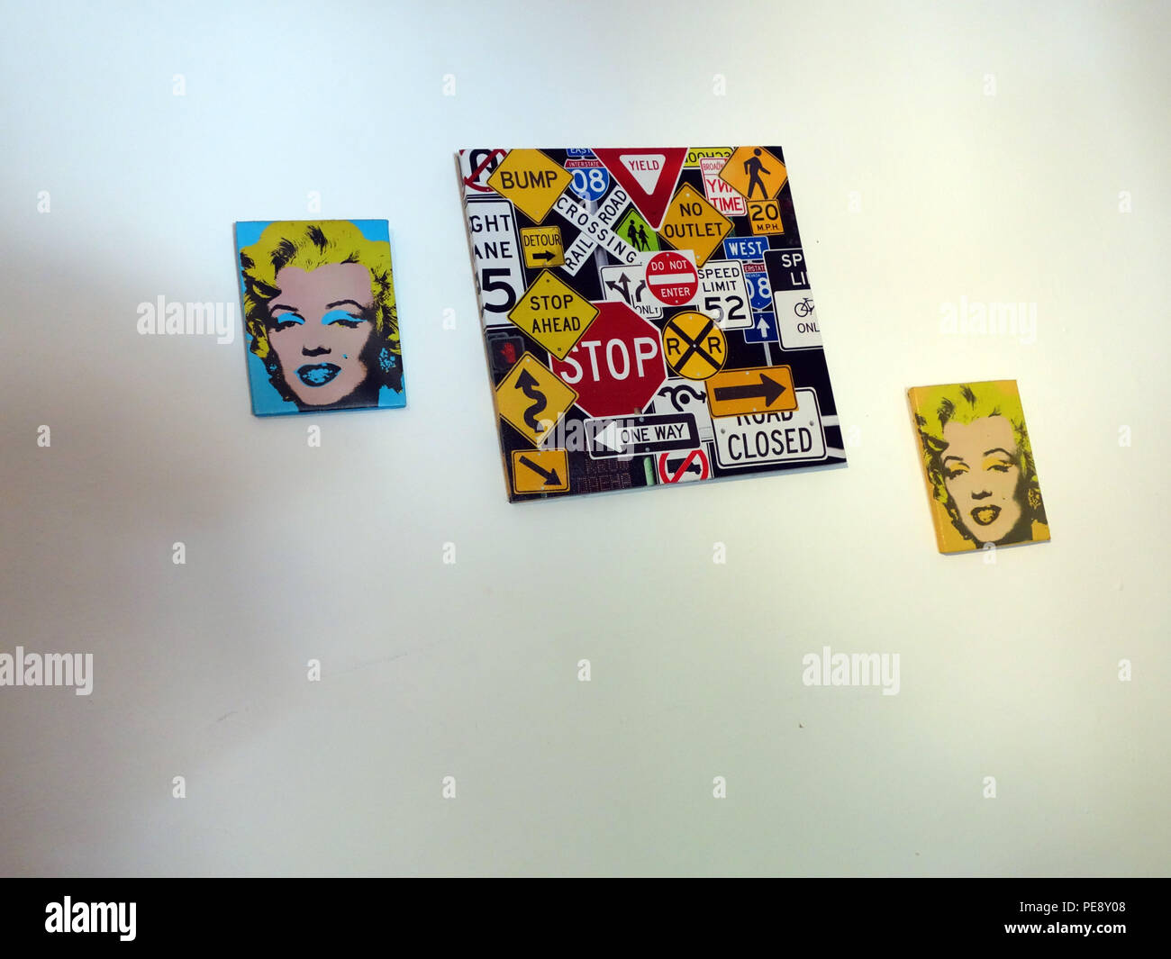 3 marilyn monroe posters on a 20 year old girls bedroom in a large French house - Stock Image