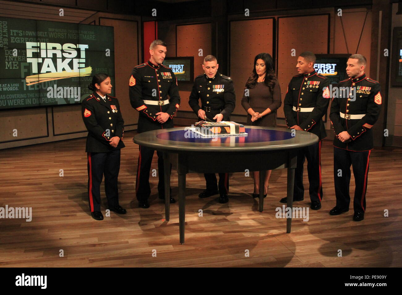 1st Lt. Stefan Milan, center left, explains the Marine Corps Birthday Cake Cutting Ceremony on ESPN First Take to Molly Qerim, Nov. 5. The Marines, all from Marine Recruiting Station Springfield, 1st Marine Corps District, appeared on the show in light of the Marine Corps' 240th birthday taking place on Nov. 10. - Stock Image