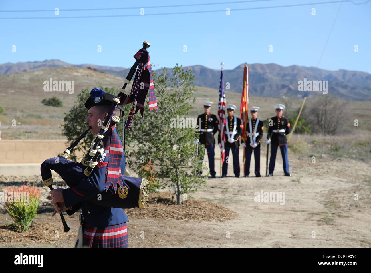 "U.S. Coast Guard Petty Officer 2nd Class Jeremy Cook, left, plays ""Amazing Grace"" on a set of bagpipes during a ceremony honoring members of 2nd Battalion, 1st Marine Regiment who gave their lives during the Vietnam War. During the ceremony, plaques bearing the names of the fallen were dedicated in their honor at the Camp Horno Memorial Garden aboard Camp Pendleton. (U.S. Marine Corps photo by Sgt. Paris Capers/ Released) Stock Photo"