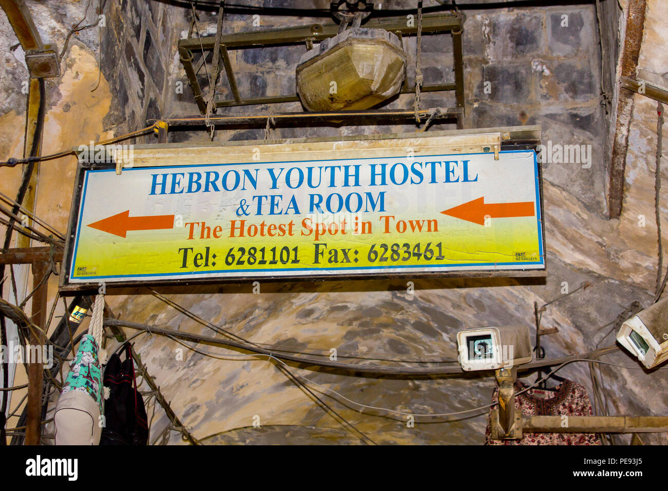 11 May 2018 An overhead sign pointing to the Hebron Youth Hostel in the Arab Souk within the old walled city of Jerusalem Israel - Stock Image