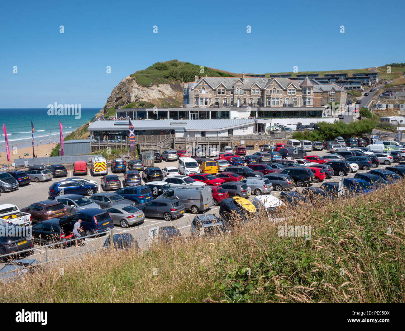 Packed , busy, crowded beach car parks at Watergate Bay near Newquay Cornwall UK in the hot summer of 2018 - Stock Image