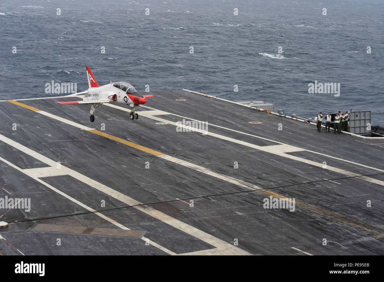 151108-N-QD363-123  ATLANTIC OCEAN (Nov. 8, 2015) – A T-45C Goshawk attached to Training Air Wing (CTW) 1 lands on the flight deck of the aircraft carrier USS Dwight D. Eisenhower (CVN 69). Dwight D. Eisenhower is underway conducting carrier qualifications. (U.S. Navy photo by Mass Communication Specialist 3rd Class Jameson E. Lynch/Released) - Stock Image