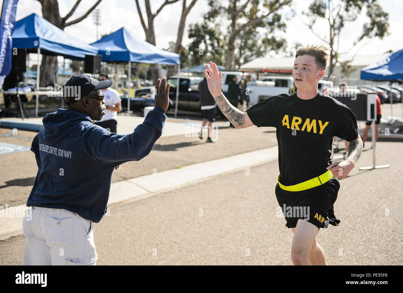 NAVAL BASE SAN DIEGO (Nov. 10, 2015)  Servicemembers cheer each other on during an MWR Veterans Day run or walk. The Veterans Day 2 mile run or 1 mile walk was sponsored through MWR and over 300 people attended. (U.S. Navy photo by Mass Communication Specialist 2nd Class Mark El-Rayes/Released) - Stock Image