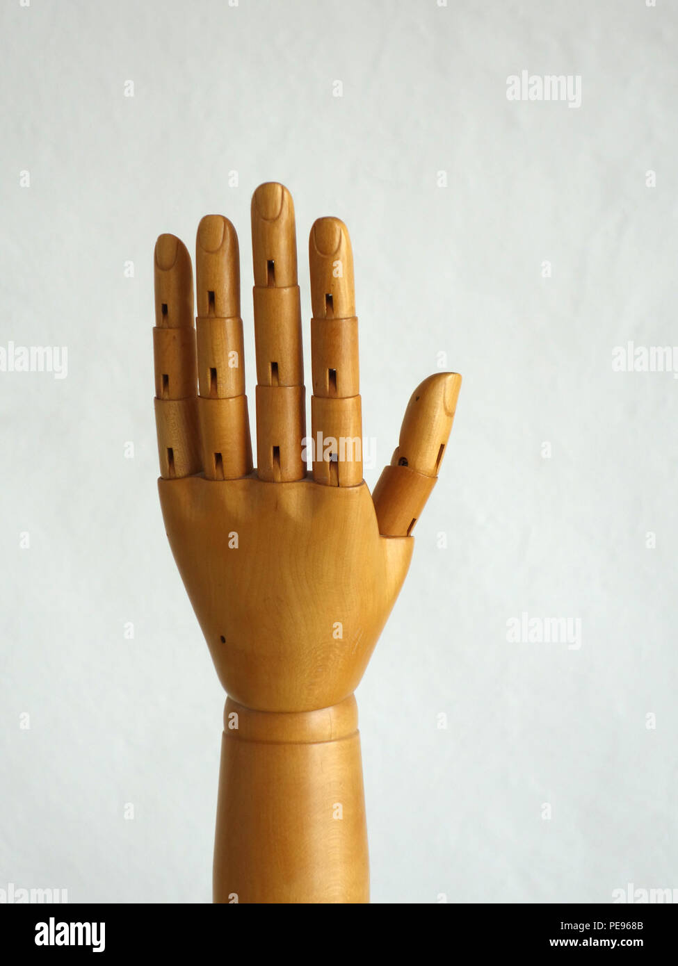 Wooden Hand Manikin making five finger gestures - Stock Image