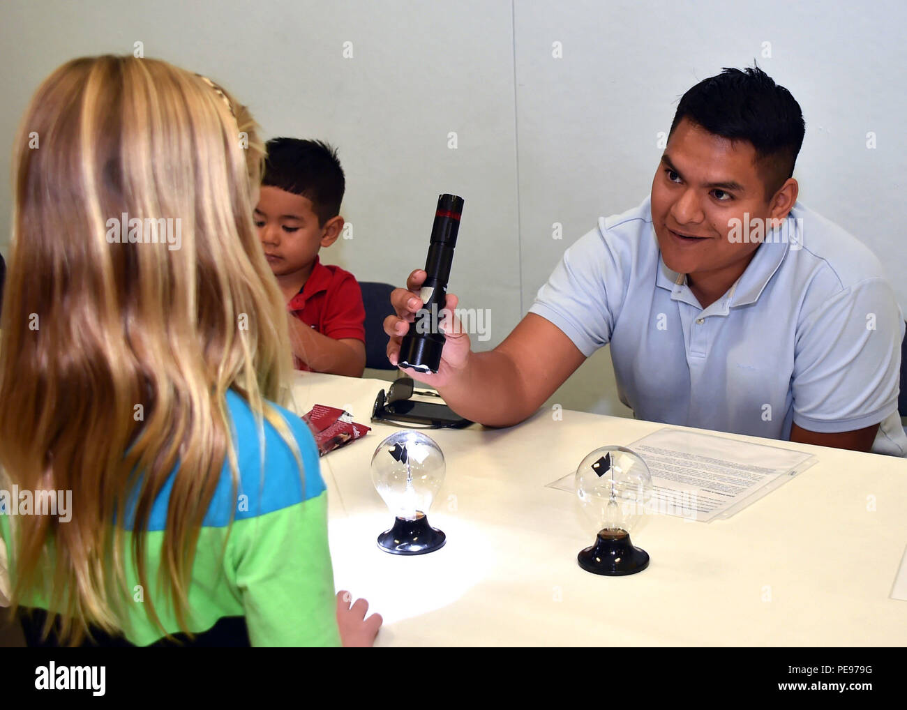 "U.S. Air Force Maj. Luis Muñoz, a section chief for testing and evaluation for the Global Positioning Directorate with the Space and Missile Systems Center demonstrates unique features of magnetism and radiometry to students from Pt. Vicente Elementary School in Rancho Palos Verdes, Calif., as part of a STEM event titled ""Science Night"" Nov. 13, 2015.  (U.S. Air Force photo by Sarah Corrice/RELEASED.) - Stock Image"