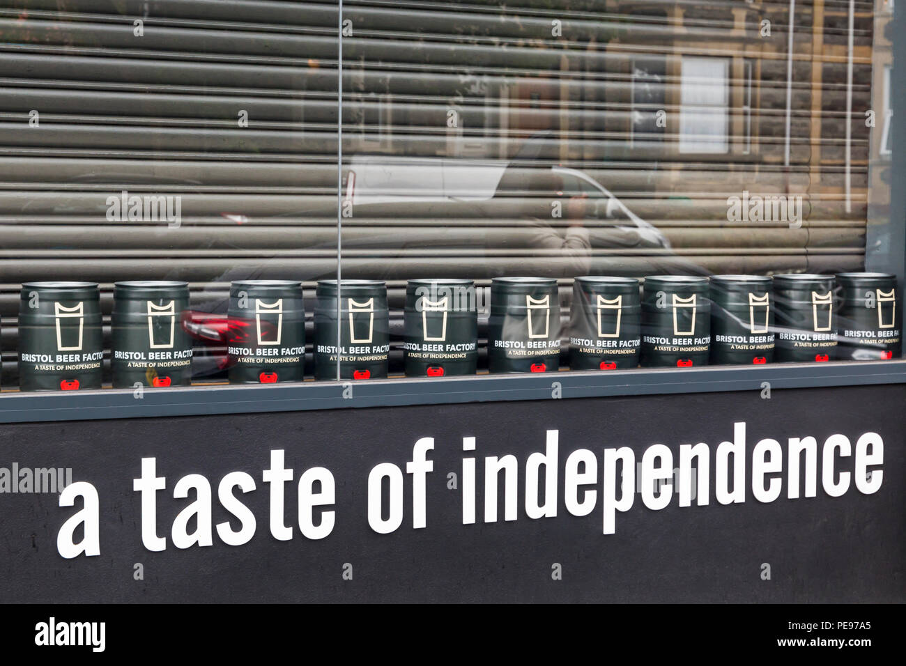 Bristol Beer Factory - a taste of independence, mini tins of Independence in window at North Street, Southville, Bristol on a wet rainy day in August - Stock Image