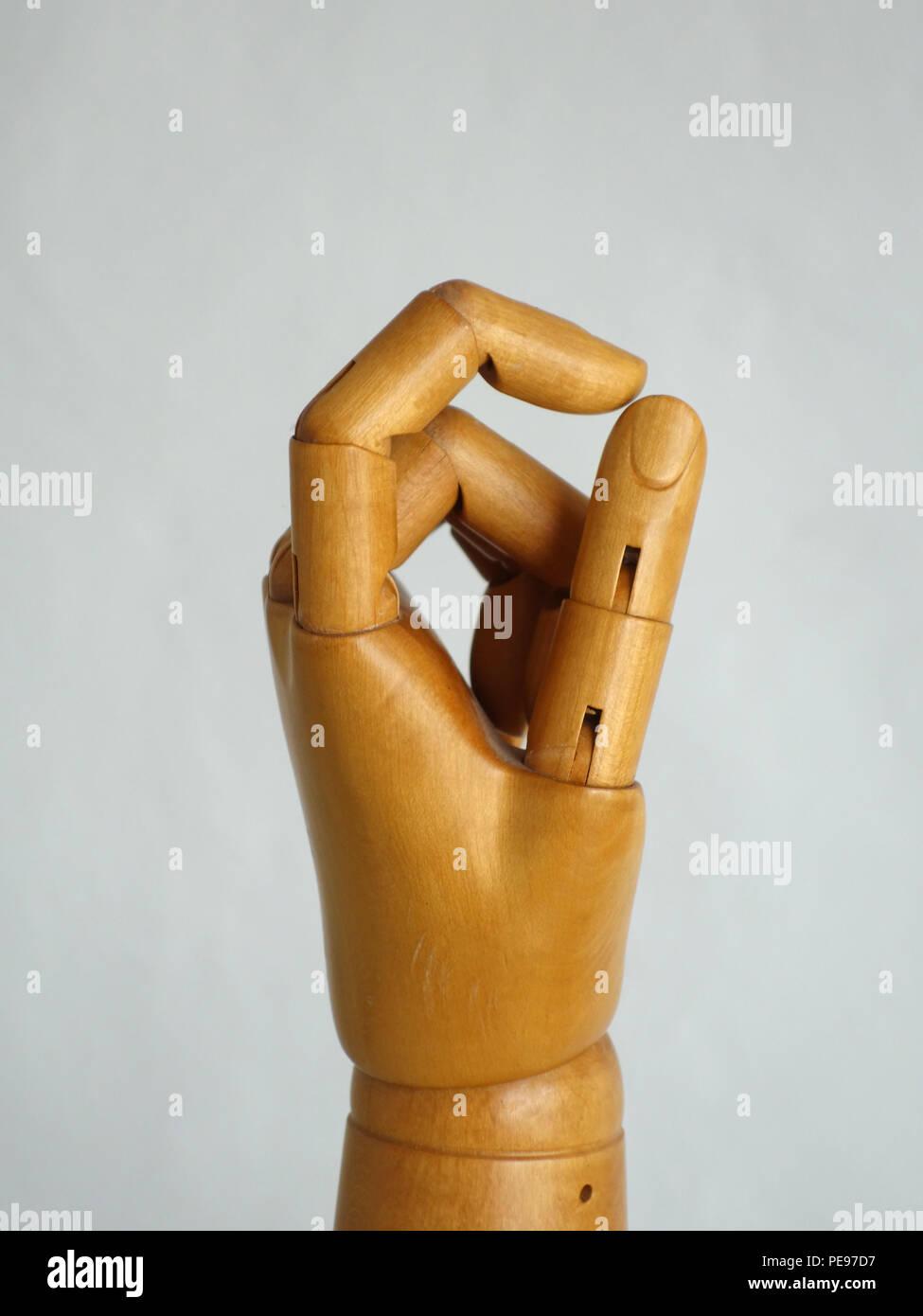 Wooden Hand Manikin making all good zero gestures Stock Photo