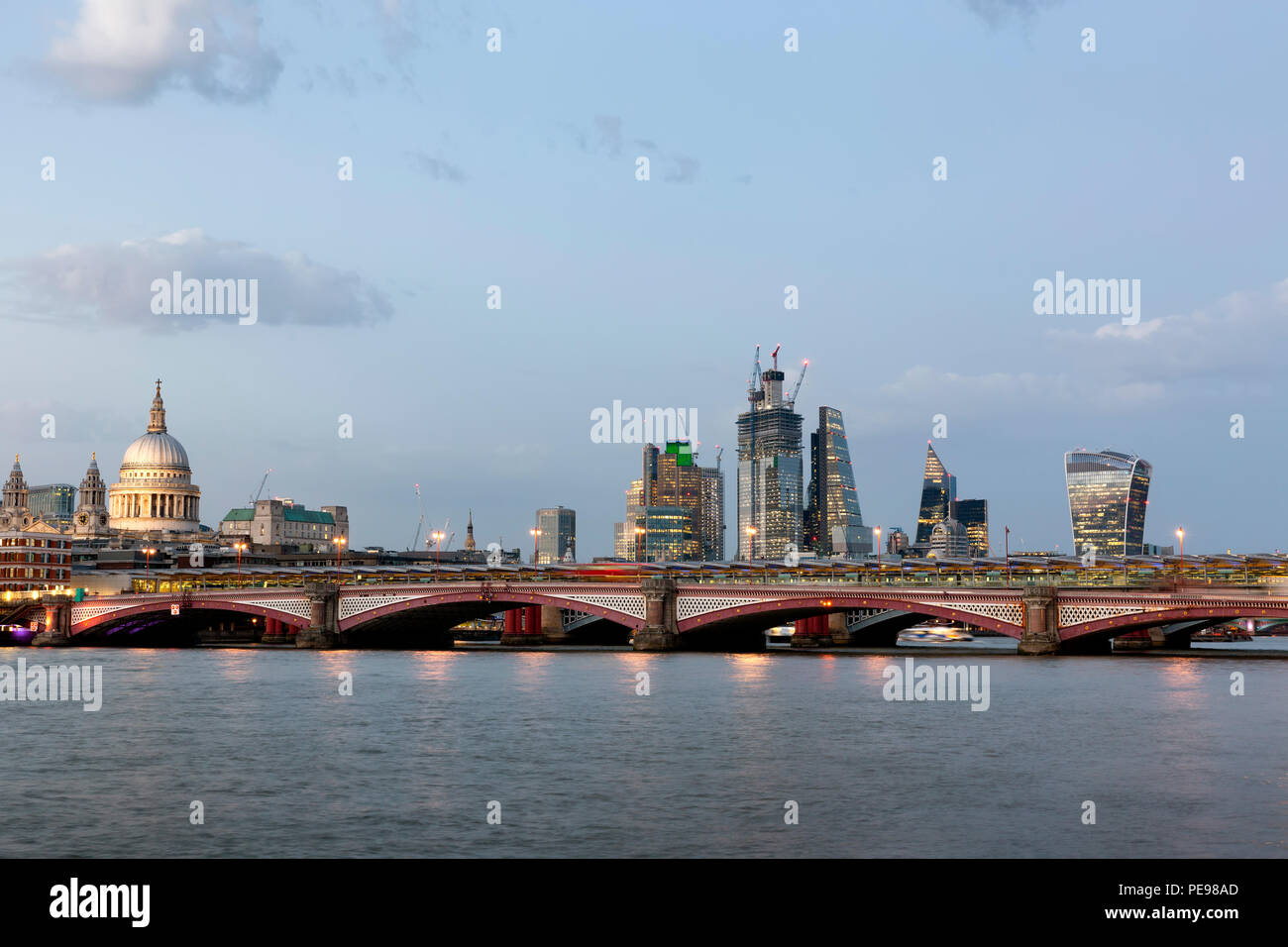 Blackfriars Bridge and City of London viewed from the South Bank of the River Thames at Twilight - Stock Image