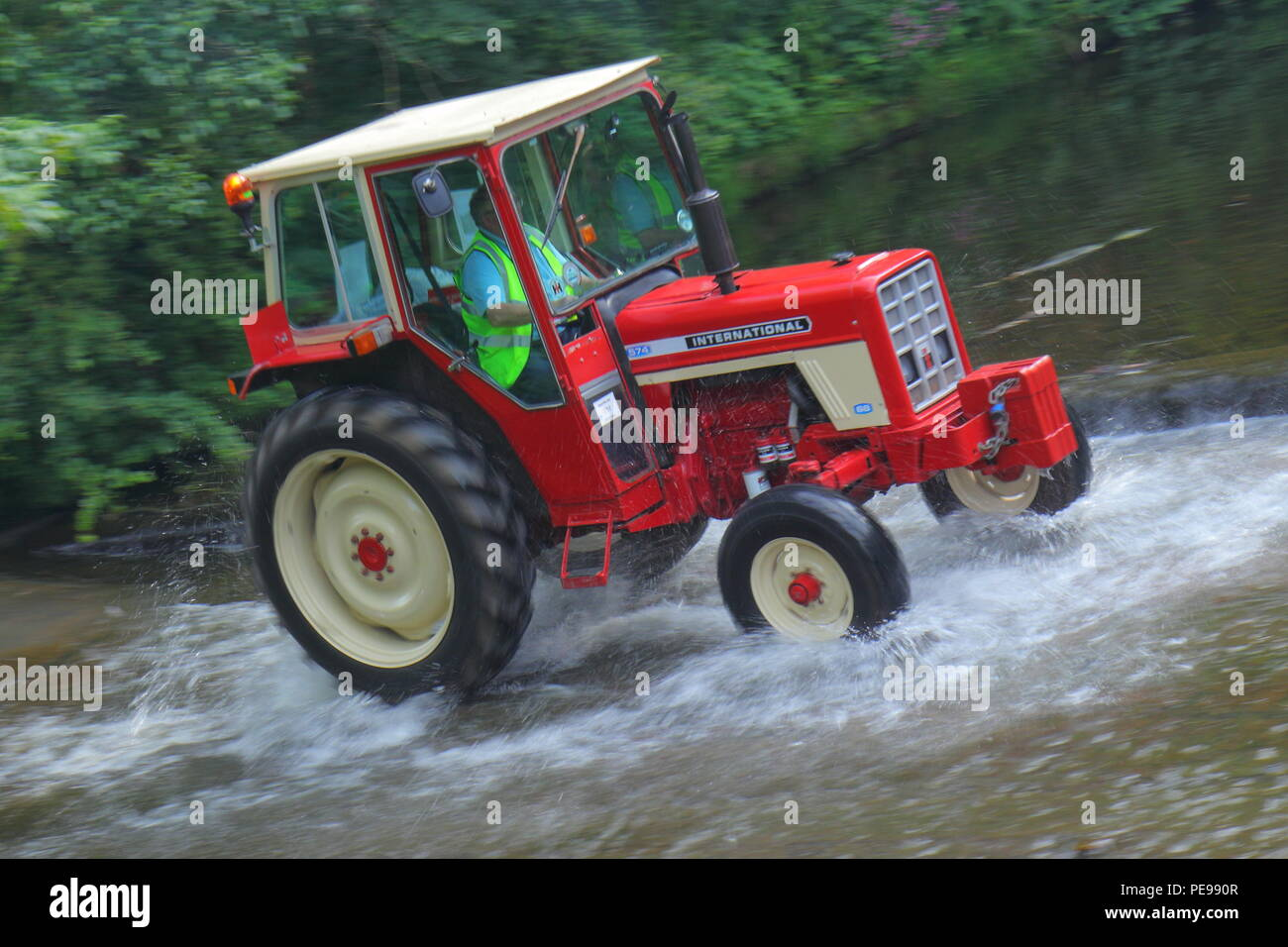 An International 574 Tractor Drives Through The River Skell In Ripon With A Convoy Of Other Tractors Which Set Off From Newby Hall Festival
