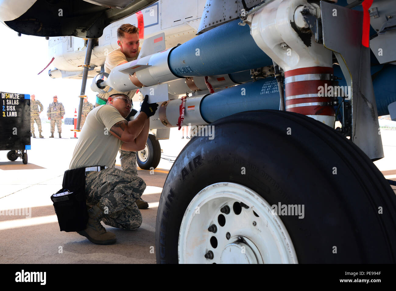 Airmen Assigned To The 354th Aircraft Maintenance Unit Work Together Load A Guided Bomb