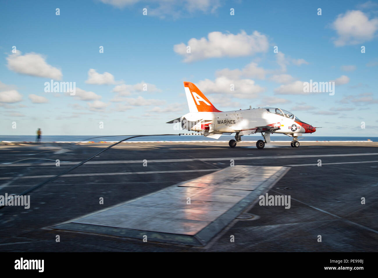 151106-N-KK394-083 ATLANTIC OCEAN (Nov. 6, 2015) – A T-45C Goshawk attached to Training Wing (CTW) 2 makes an arrested landing on the flight deck of the aircraft carrier USS Dwight D. Eisenhower (CVN 69). Dwight D. Eisenhower is underway conducting carrier qualifications. (U.S. Navy photo by Mass Communication Specialist Seaman Anderson W. Branch/Released) - Stock Image