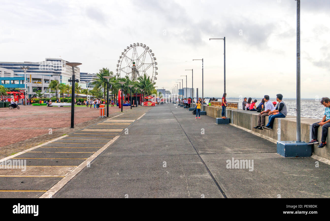 Pasay, Metro Manila, Philippines - July 28, 2018: People at SM Mall of Asia Bay Area - Stock Image