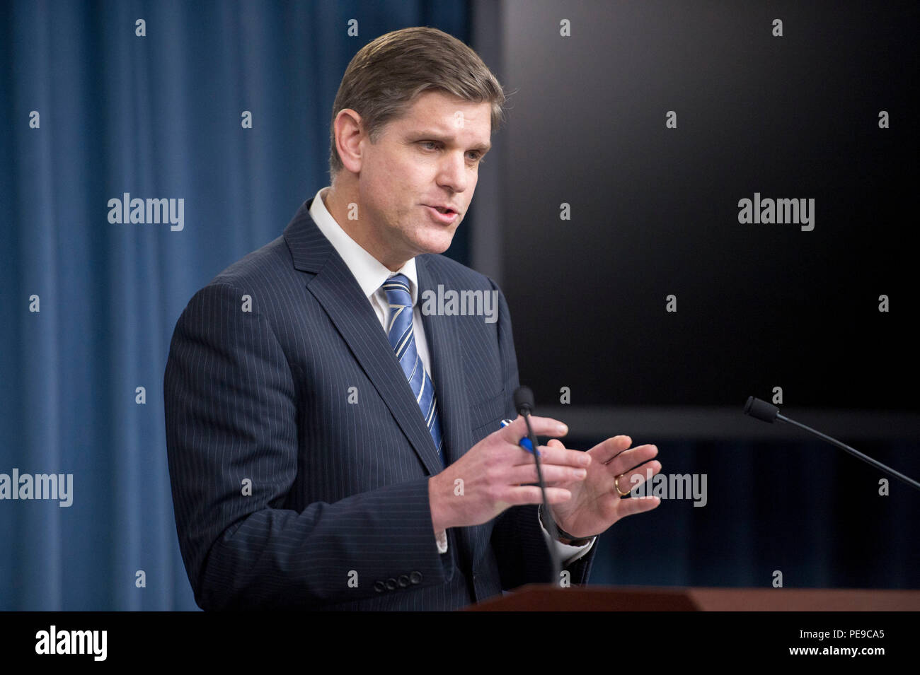 Pentagon Press Secretary Peter Cook briefs reporters on current events within the Department of Defense at the Pentagon Nov. 12, 2015. (Photo by Senior Master Sgt. Adrian Cadiz)(Released) - Stock Image