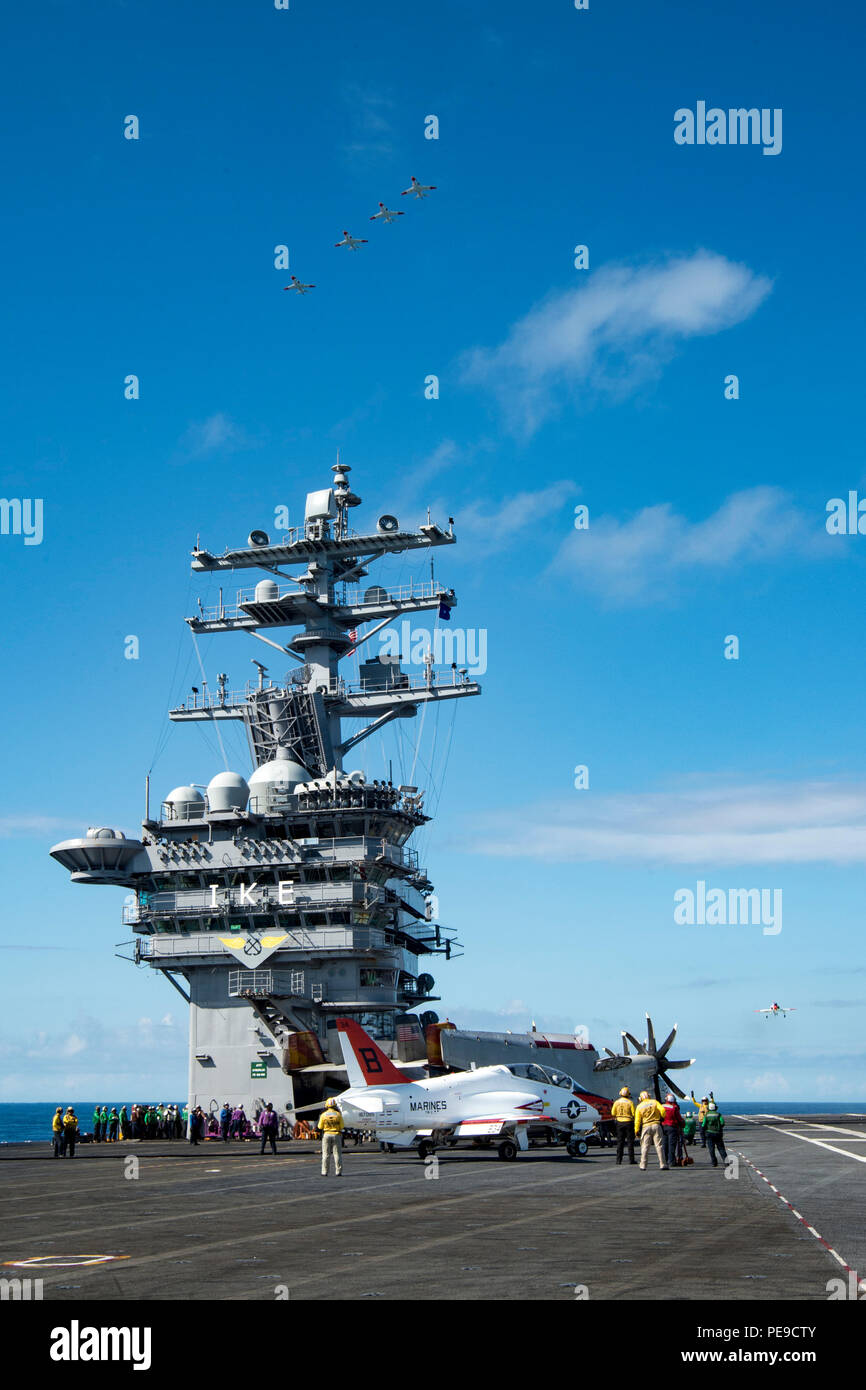 151107-N-KK394-161  ATLANTIC OCEAN (Nov. 7, 2015) – Four T-45C Goshawks fly in formationover the aircraft carrier USS Dwight D. Eisenhower (CVN 69). Dwight D. Eisenhower is underway conducting carrier qualifications. (U.S. Navy photo by Mass Communication Specialist Seaman Anderson W. Branch/Released) - Stock Image