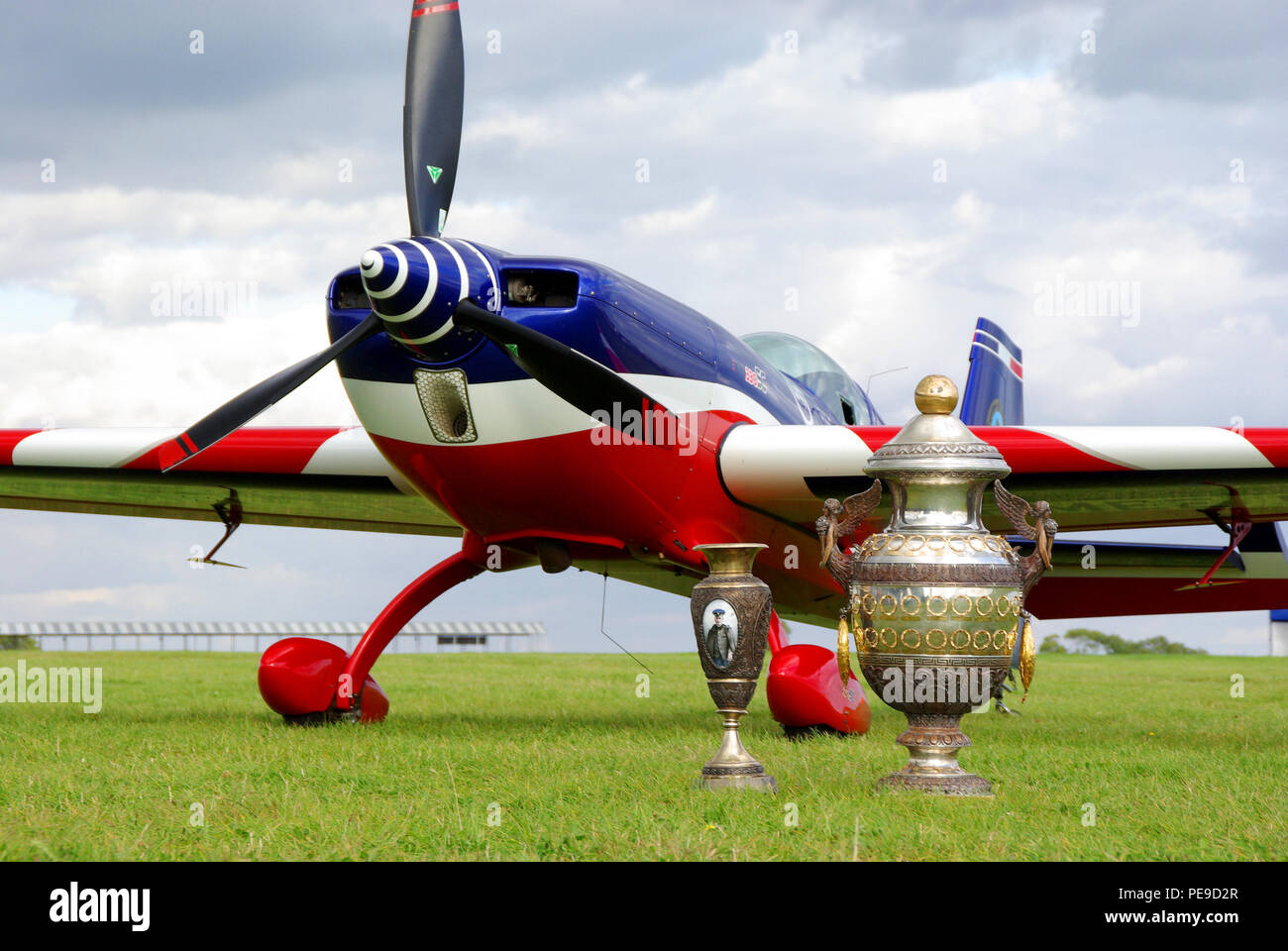 French team Extra 330 aerobatic plane at the World Aerobatics Championships WAC at Silverstone, UK. Winner aircraft with trophy, trophies. Aresti Cup - Stock Image