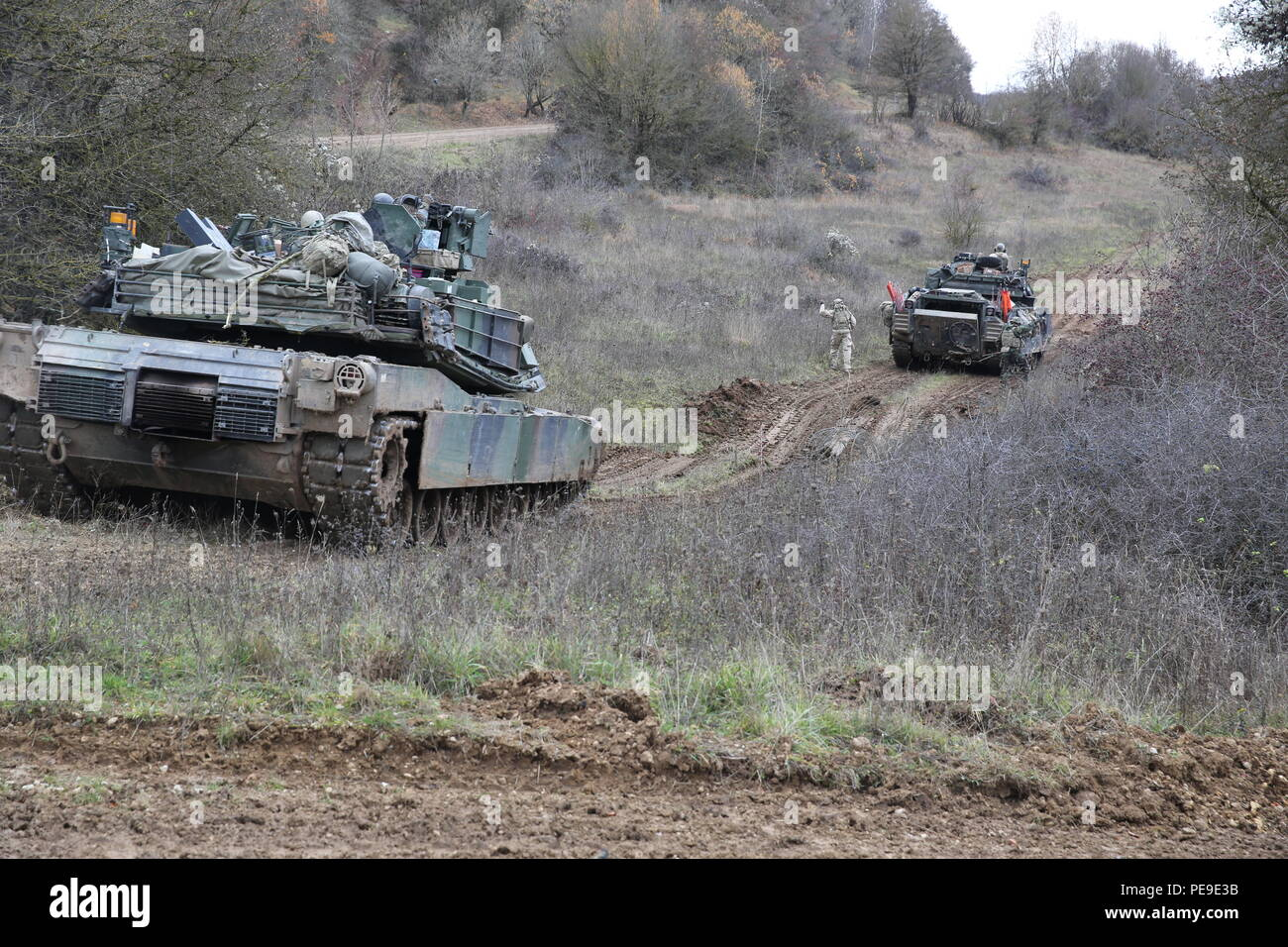 U.S. Soldiers of Bravo Company, 10th Brigade Engineer Battalion, 1st Armored Brigade, 3rd Infantry Division move through a breach while conducting breach operations during exercise Combined Resolve V at the U.S. Army's Joint Multinational Readiness Center in Hohenfels, Germany, Nov. 9, 2015. Exercise Combined Resolve V is designed to exercise the U.S. Army's regionally allocated force to the U.S. European Command area of responsibility with multinational training at all echelons. Approximately 4,600 participants from 13 NATO and European partner nations will participate. The exercise involves  - Stock Image