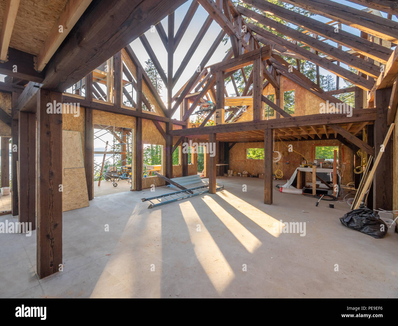 Interior of a modern post and beam house construction - Stock Image