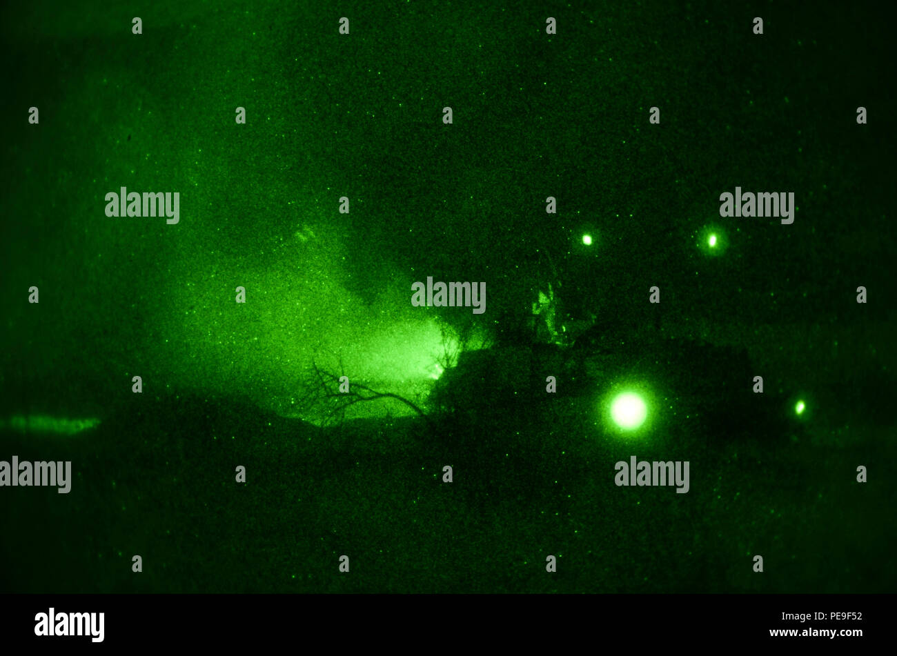 Soldiers of 1st Armored Brigade Combat Team, attached to 5th Squadron, 7th Cavalry Regiment, 3rd Infantry Division, stationed at Fort Stewart, Ga., shoot the M240 Coaxial machine gun that is mounted to the M1A2 System Enhancement Package Version 2 Abram Tank at enemy targets during a night operations field training exercise in support of Operation Atlantic Resolve at Novo Selo Training Center, Bulgaria, Nov. 17, 2015. (U.S. Army photo by Staff Sgt. Steven M. Colvin/Released) - Stock Image