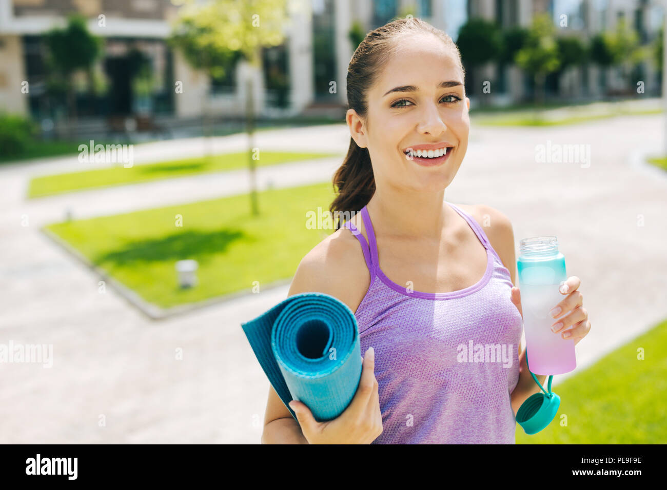 Delighted nice woman leading healthy lifestyle - Stock Image