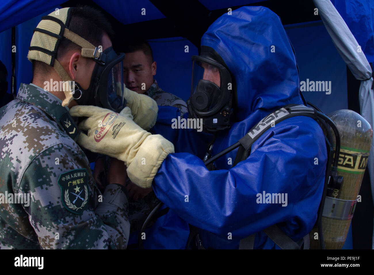 Soldiers with the People's Republic of China People's Liberation Army get some hands-on learning on the use of decontamination equipment used by the U.S. forces during emergency and disaster relief efforts as part of the Disaster Management Exchange held at Joint Base Lewis-McChord, Wash., Nov. 20, 2015. The DME is an opportunity to share humanitarian aid and disaster relief lessons learned from real-world events and hopes to improve U.S. and Chinese dialog for HA/DR events in the future. - Stock Image
