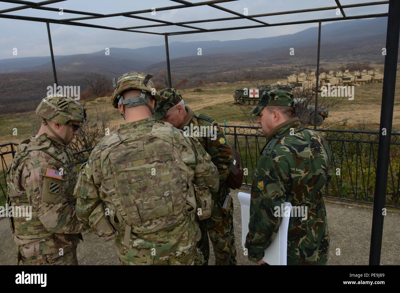Bulgarian and U.S. Army key leaders discuss the areas in which the soldiers will conduct a series of tactical movements during Exercise Peace Sentinel at Novo Selo Training Center, Bulgaria, Nov. 21, 2015. Peace Sentinel is a joint exercise that focuses on interoperability between the Bulgarian and U.S. forces. (Photo by Staff Sgt. Steven M. Colvin/Released) - Stock Image